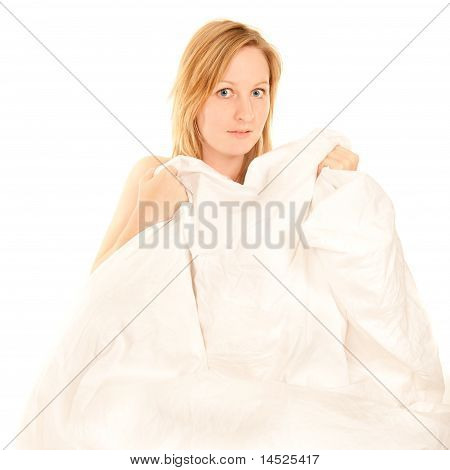 Naked Young Woman Hiding Behind Bedclothes