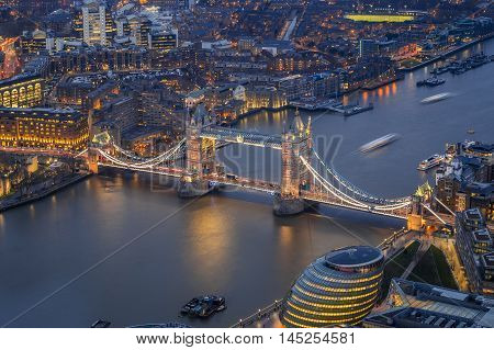 London England - Aerial view of the world famous Tower Bridge City Hall and the Tower of London by night