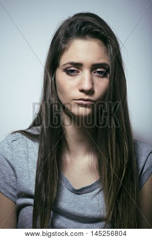 problem depressioned teenage with messed hair and sad face, real junky bad looking girl close up
