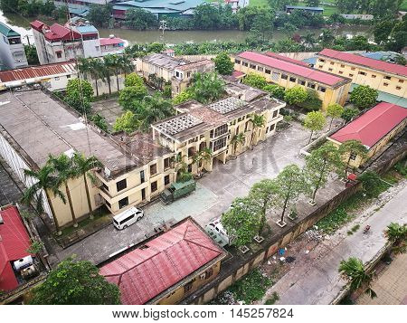 HANOI, VIETNAM - AUG 1, 2016: View from above of a prison locating among a civilian area in the suburb of Hanoi capital, Vietnam.