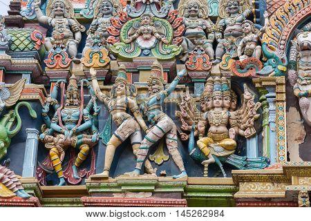 Madurai India - October 19 2013: Closeup of Lord Vishnu as Narasimha with his lion head and Lord Murugan on his peacock. Facade of West Gopuram at Meenakshi Temple.