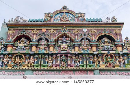 Madurai India - October 19 2013: Facade at Nagara Mandapam showing Lakshmi and her two elephants together with a row of gods including Meenakshi Ganesha Kali Murugan