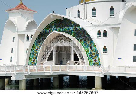 MALACCA, MALAYSIA -JANUARY 26, 2014: Malacca Straits Mosque at Malacca, Malaysia. Built on the on edge of the man-made Island called Malacca Island