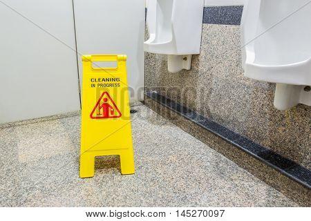 Toilet floor with mop bucket and