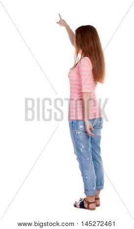 Back view of  pointing woman. beautiful redhaired  girl . girl shows something to someone. Rear view people collection.  backside view of person.  Isolated over white background. Girl in a white T