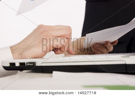 Office manager working with laptop