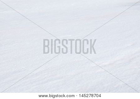 White, clear, and pure snow on the background in the winter season at Antarctica