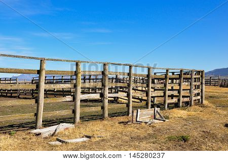 Wooden stable and blue sky background at South America