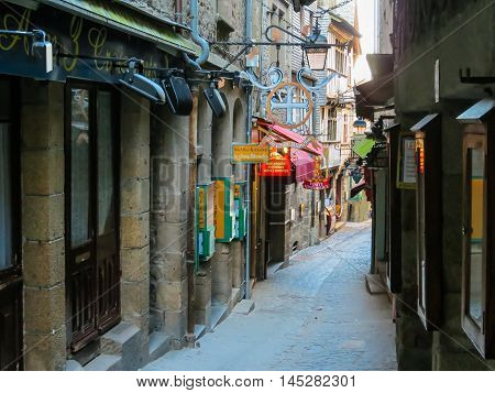 MONT SAINT-MICHEL, FRANCE - MAY 05, 2014: Medieval street of Mont Saint-Michel, France