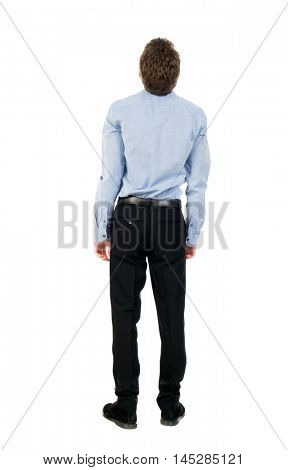 back view of Business man looks. Curly businessman in a light shirt looks upward.