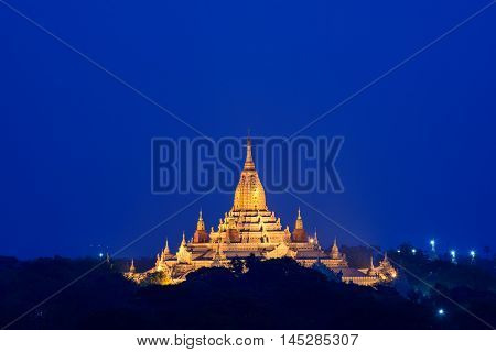 golden pagoda in early mornig with blue sky background