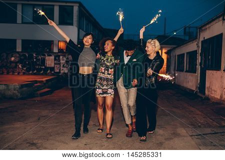 Group Of Friends Enjoying Out With Sparklers