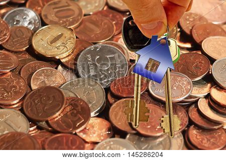The keys to the apartment on a background of money . The concept of changing prices on the market