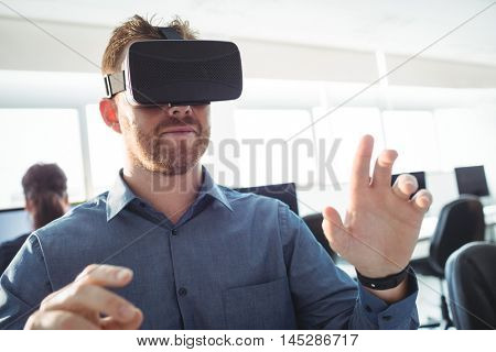 Mature student using virtual reality headset to help with studying at college