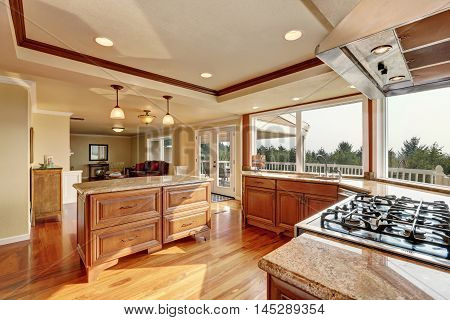 Photo Of Open Concept Kitchen With Cabinets And Granite Countertops.