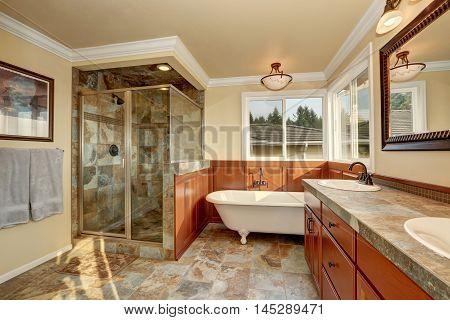 Bathroom With Natural Stone Tile And Beige Walls.