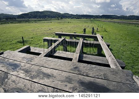 VEJLE DENMARK - AUGUST 22 2016: Harald Bluetooth let in the winter of 979 erect a 760 meter long bridge of oak across Vejle river valley. In 2011 behaved Vejle Museum reconstruction of the Ravning Bridge.