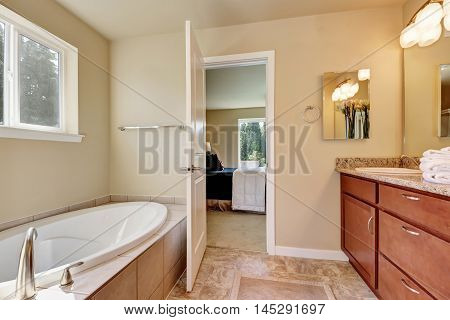Photo Of A Mid-sized Bathroom With Wood Cabinets
