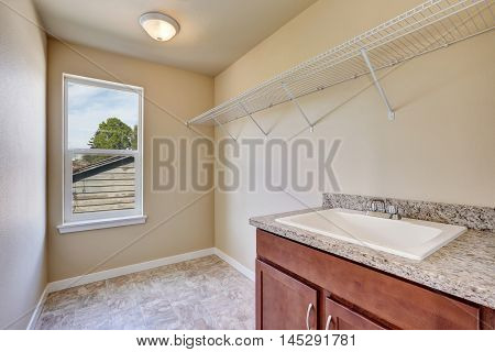 Empty Laundry Room Interior With Tile Flooring