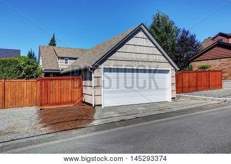 White Door Garage And Fenced Back Yard.