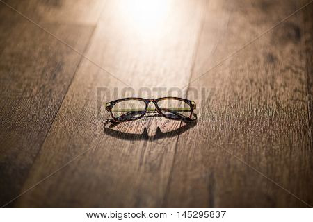 Spectacles isolated on wooden table