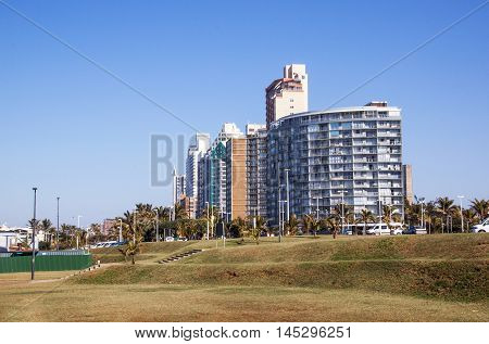 Empty Lawn Area Against Comercial And Residential Buildings