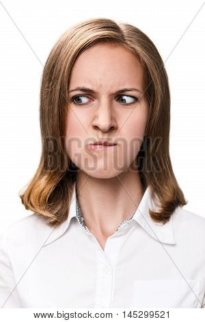 Young woman with very angry face isolated on white background.