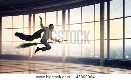 Man fly besom in office . Mixed media