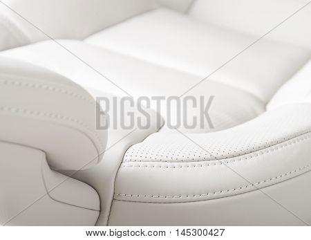 Modern car interior, white perforated leather, focus on stitch
