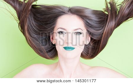 Woman With Hair In Motion As Beauty Pose Concept