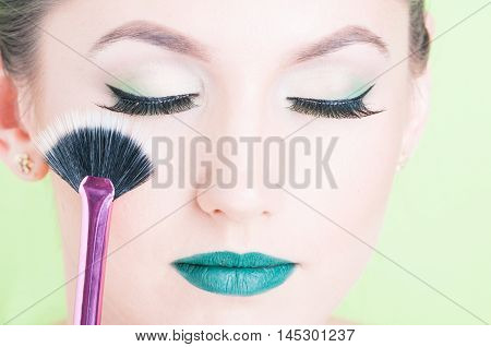 Close-up Of Woman Face Wearing Professional Make-up