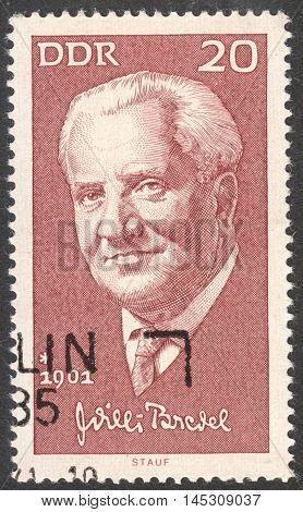 MOSCOW RUSSIA - CIRCA AUGUST 2016: a stamp printed in DDR shows a portrait of Willi Bredel the series