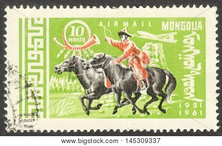 MOSCOW RUSSIA - CIRCA AUGUST 2016: a stamp printed in MONGOLIA shows a postman on Horse (Equus ferus caballus) the series