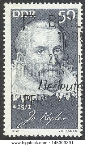 MOSCOW RUSSIA - CIRCA AUGUST 2016: a stamp printed in DDR shows a portrait of Johannes Kepler the series