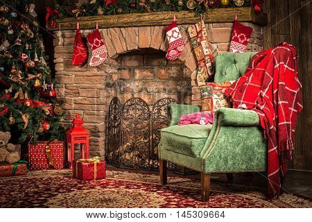 Christmas decorations of the room: fireplace, chair, Christmas tree and gifts