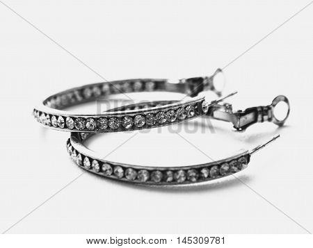 Earrings on a white background decoration bijouterie gift jewelry stone diamond metal gold black white