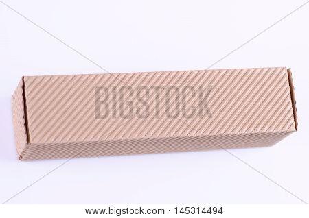 Flute small carton box on white background.