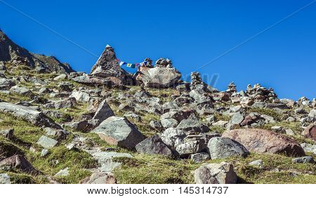 Mountain Peak With Colorful Prayer Flags