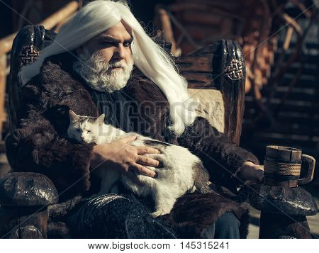 Druid With Cat And Mug