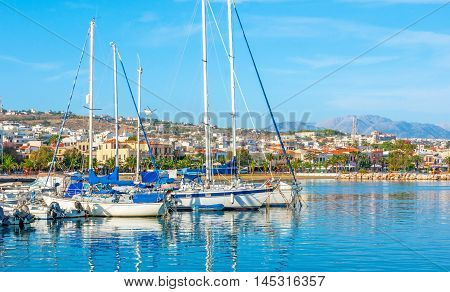 The the view from the new port on the coastline of Rethymno with the modern districts on the hilly area Crete Greece.