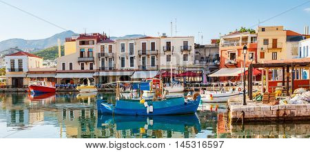 The old port is the popular tourist location there are a lot of fishing and tourist boats for hire cafes and taverns to relax and taste the local cuisine Rethymno Greece.