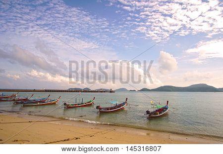 Longtail boats at the beautiful beach on Phuket Island, Thailand.
