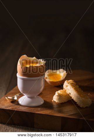 Soft boiled egg with toasted bread slices