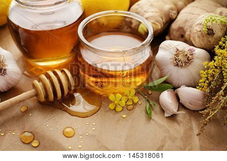 Honey, garlic, herbs, lemon and ginger - natural medicine, healthy food