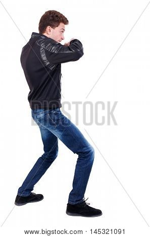 back view of guy funny fights waving his arms and legs. Curly guy in a black leather jacket fights waving his arms.
