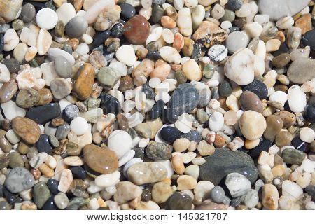 Beach with macro pebbles, sea polished pebbles