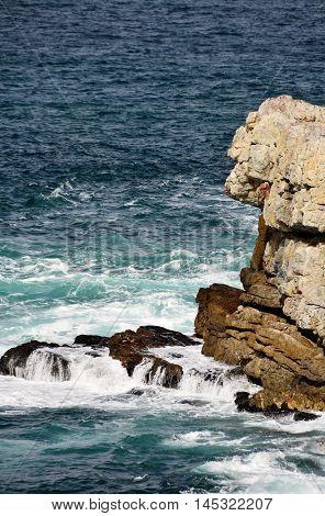 Seascape with rocks in the blue green Atlantic Ocean