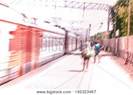 City commuters. High key blurred image of people on train station. Unrecognizable faces, bleached effect.