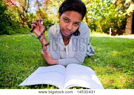 Young Student Reading Books At The School Park