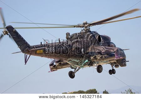 ZARAGOZA SPAIN - MAY 20 2016: Special painted Czech Republic Air Force Mil Mi-24 Hind attack helicopter taking off from Zaragoza airbase.